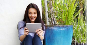 Woman entering Scavenger Hunt Contest on her Tablet